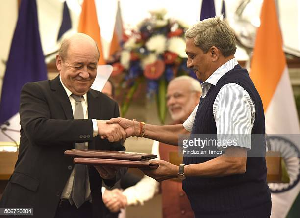Defence Minister Manohar Parrikar and his French counterpart JeanYves Le Drian exchange the files of agreements on the buying of Rafale fighter jets...