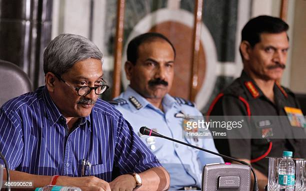 Defence Minister Manohar Parrikar with Air Chief Marshal Arup Raha and Army Chief General Dalbir Singh Suhag during a press conference to announce...