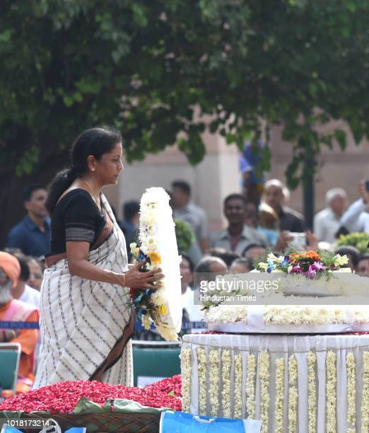 Defence Minister Nirmala Sitharaman pays her final respects during the cremation ceremony of former Prime Minister Atal Bihari Vajpayee at Rashtriya...