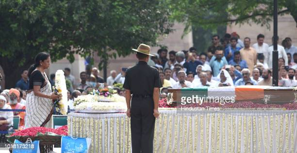 Defence Minister Nirmala Sitharaman pays her last respect during the cremation ceremony of former Prime Minister Atal Bihari Vajpayee at Rashtriya...