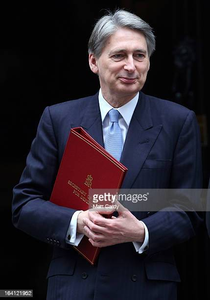 Defence Minister Philip Hammond leaves a cabinet meeting in Downing Street ahead of the Chancellor of the Exchequer George Osborne presenting his...