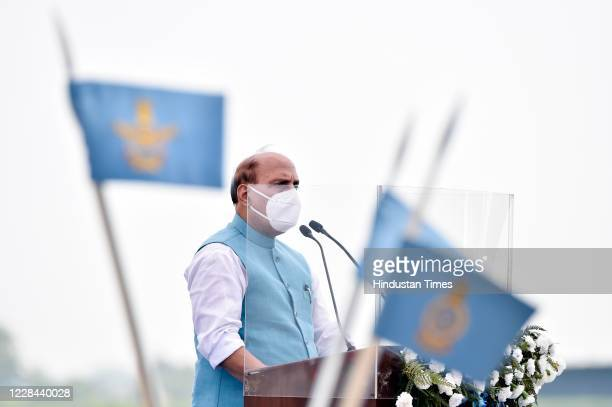 Defence Minister Rajnath Singh address the gathering during the induction ceremony of Rafale aircrafts, at Indian Air Force Airbase on September 10,...