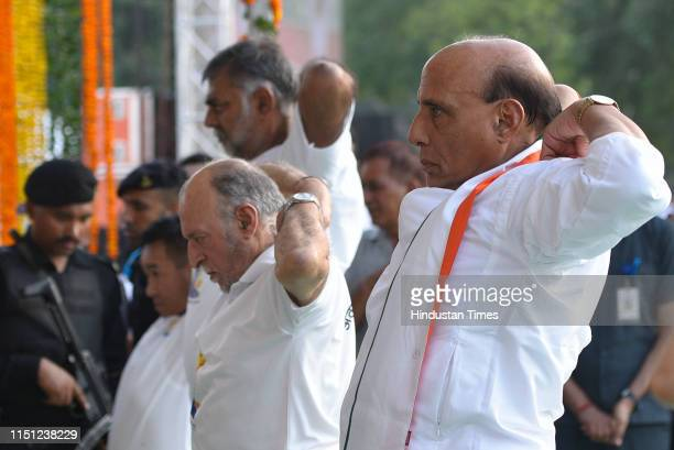 Defence Minister Rajnath Singh along with Lieutenant Governor of Delhi Anil Baijal and other political leaders participate in a mass yoga session on...