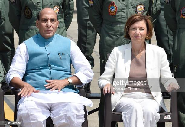 Defence Minister Rajnath Singh and French Armed Forces Minister Florence Parly pose for a photograph during the induction ceremony of Rafale...
