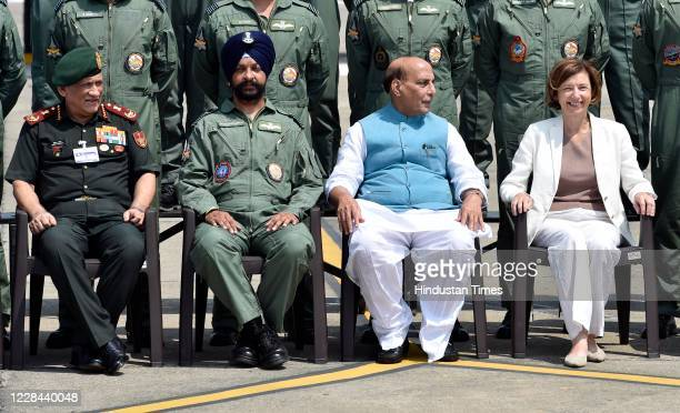 Defence Minister Rajnath Singh and French Armed Forces Minister Florence Parly pose for a photograph with members of the Indian Air Force during the...