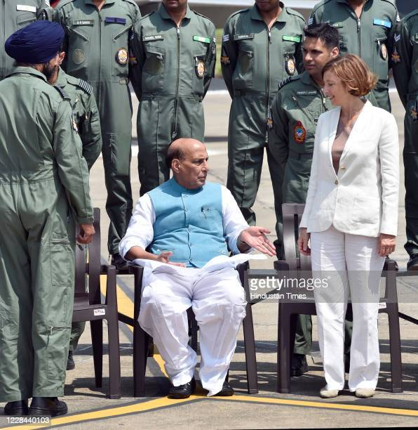 Defence Minister Rajnath Singh and French Armed Forces Minister Florence Parly with members of the Indian Air Force during the induction ceremony of...