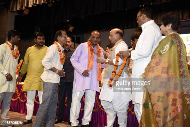 Defence Minister Rajnath Singh greets BJP workers with Minister of Law and Justice Brajesh Pathak and Mayor Sanyukta Bhatia also present in BJP...