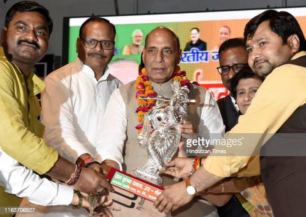 Defence Minister Rajnath Singh is presented with a Krishna idol by BJP workers with Minister of Law and Justice Brajesh Pathak and Mayor Sanyukta...