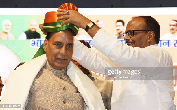 Defence Minister Rajnath Singh is presented with a turban by Minister of Law and Justice Brajesh Pathak in BJP Karyakarta Abhinandan Samaroh at CMS...