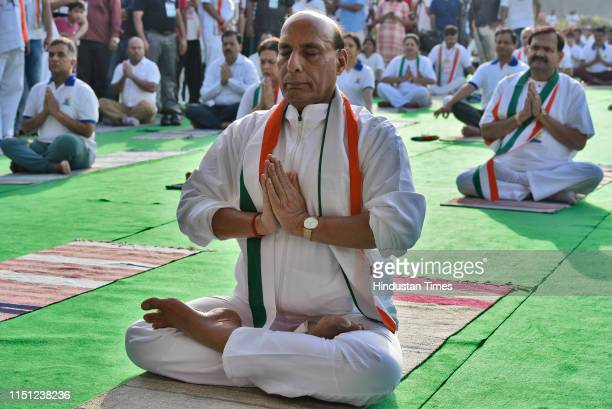 Defence Minister Rajnath Singh participates in a mass yoga session on International Yoga Day at Rajpath on June 21 2019 in New Delhi India The...
