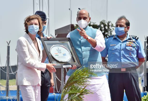 Defence Minister Rajnath Singh presents a momento to French Armed Forces Minister Florence Parly during induction ceremony of Rafale Aircrafts, at...