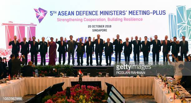 Defence ministers pose at the 5th ASEAN Defence Ministers MeetingPlus during the Association of Southeast Asian Nations security summit in Singapore...