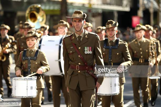 Defence personnel make their way down Elizabeth Street during the ANZAC Day parade on April 25, 2021 in Sydney, Australia. Anzac day is a national...