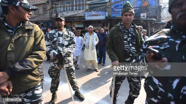 Defence personnel stand guard during a protest against Citizenship Amendment Act National Population Register National Register of Citizens and...