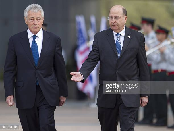 US Defence Secretary Chuck Hagel and Israel's Defence Minister Moshe Yaalon review troops at the Hakirya military base on April 22 2013 in Tel Aviv...