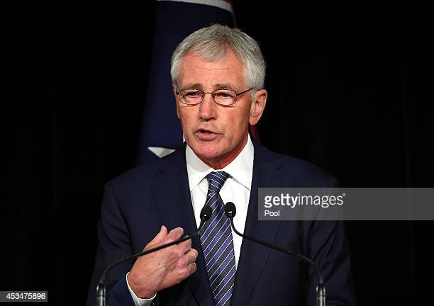 Defence Secretary Chuck Hagel holds his hand up as he speaks during a press conference with Australia's Defence Minister David Johnston on August 11,...