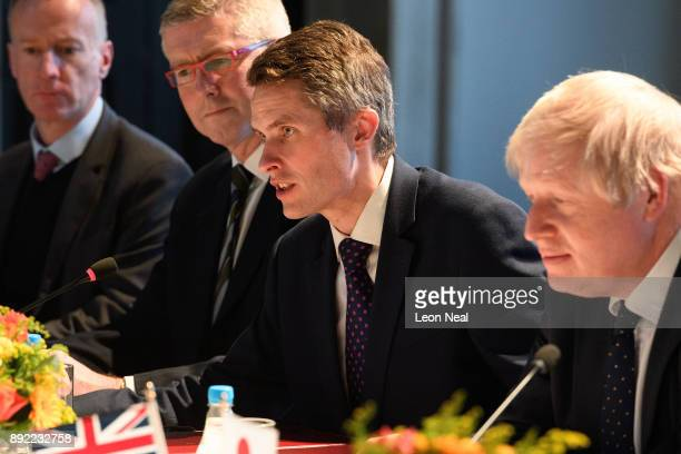 Defence Secretary Gavin Williamson and Britain's Foreign Secretary Boris Johnson speak at the head of a meeting in the Queen's House gallery on...