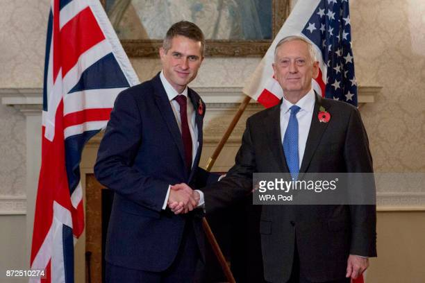 Defence Secretary Gavin Williamson and US Defence Secretary James Mattis shake hands ahead of a bilateral meeting at the Ministry of Defence...