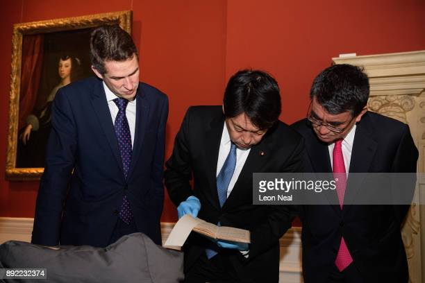 Defence Secretary Gavin Williamson Japanese Defence Minister Itsunori Onodera and Japan's Foreign Minister Taro Kono examine a selection of...