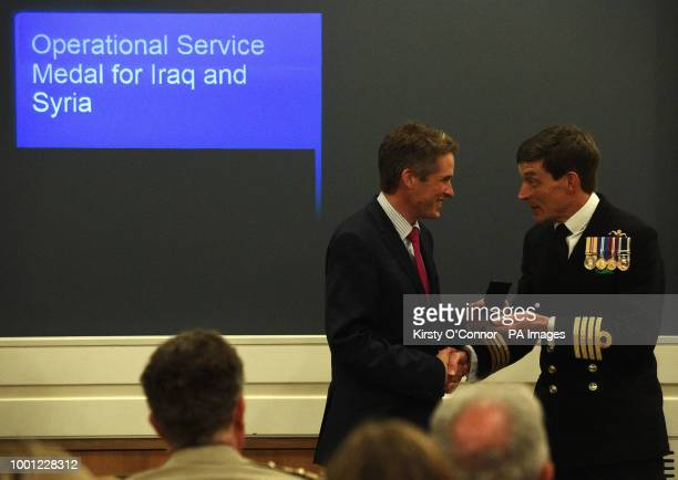 Defence Secretary Gavin Williamson presents a new Operation Shader medal to a serviceman who has contributed to the coalition fight against Daesh in...