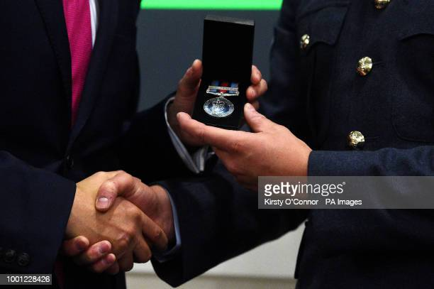 Defence Secretary Gavin Williamson presents a new Operation Shader medal to a servicewoman who has contributed to the coalition fight against Daesh...