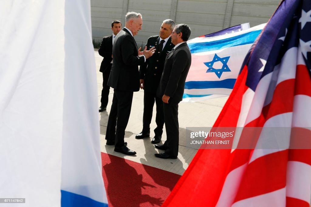 US Defence Secretary James Mattis (C-L) bids farewell to Israeli military dignitaries as he departs from Ben Gurion International Airport in Tel Aviv on April 21, 2017. /