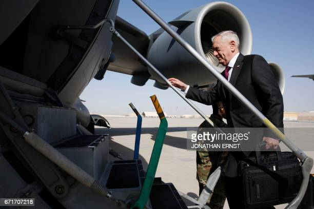 Defence Secretary James Mattis climbs up the steps as he boards a US Air Force C-17 plane en route to visit a US military base in Djibouti, in the...