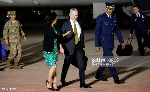 US Defence Secretary James Mattis is greeted by US ambassador to Qatar Dana Shell Smith and Staff BrigadierGeneral Abdullah Jumaan alHamad assistant...