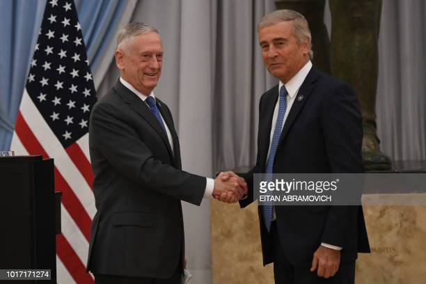 US Defence Secretary Jim Mattis and Argentina's Defence Minister Oscar Aguad shake hands at the end of a press conference at the Defence Ministry in...