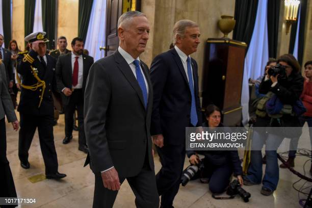 US Defence Secretary Jim Mattis and Argentina's Defence Minister Oscar Aguad arrive for a press conference at the Defence Ministry in Buenos Aires on...
