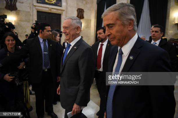 US Defence Secretary Jim Mattis and Argentina's Defence Minister Oscar Aguad leave after offering a press conference at the Defence Ministry in...
