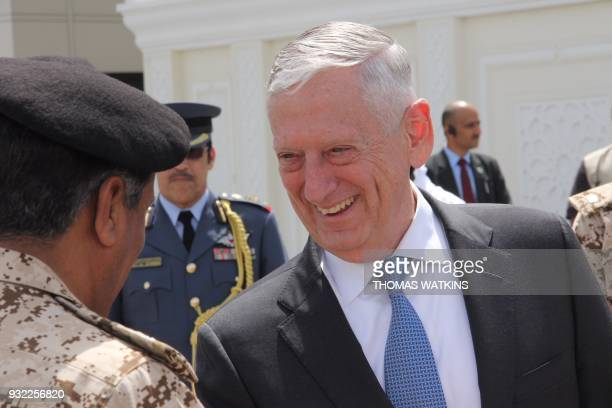 US Defence Secretary Jim Mattis shakes hands with military officials as he departs from Bahrain at Manama airport on March 15 2018 Mattis was in...