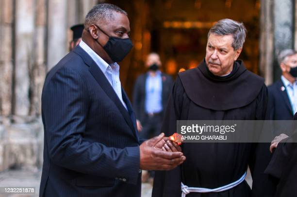 Defence Secretary Lloyd Austin speaks with Franciscan monks outside the Church of the Holy Sepulchre, traditionally believed to be the burial site of...