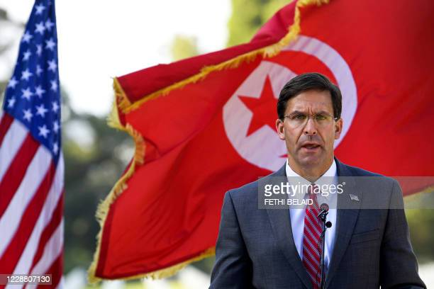 Defence Secretary Mark Esper gives a speech while visiting the North Africa American Cemetery which houses the remains of US soldiers who died during...