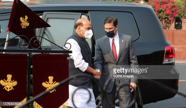 Defence Secretary Mark Esper shake hands with the Indian Defence Minister, Rajnath Singh , both wearing face masks as he arrives during a ceremonial...