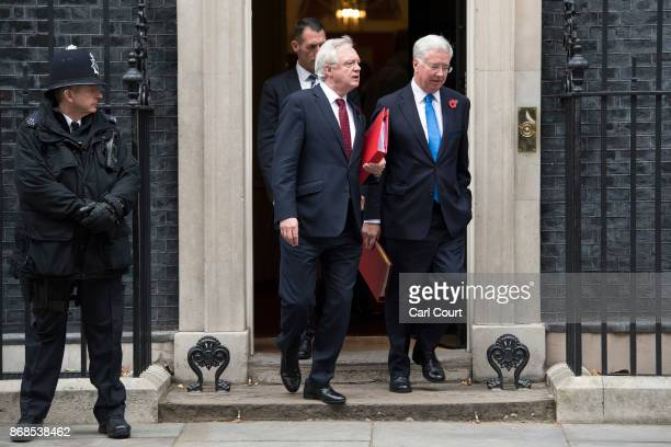 Defence secretary Michael Fallon and Brexit Secretary David Davis leave after attending a cabinet meeting in Downing Street on October 31 2017 in...