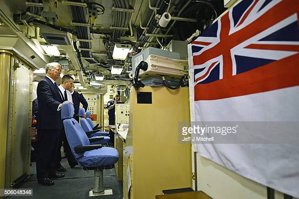 Defence Secretary Michael Fallon in the missile control centre onboard HMS Vigilant at Her Majesty's Naval Base Clyde on January 21 2016 in Rhu...