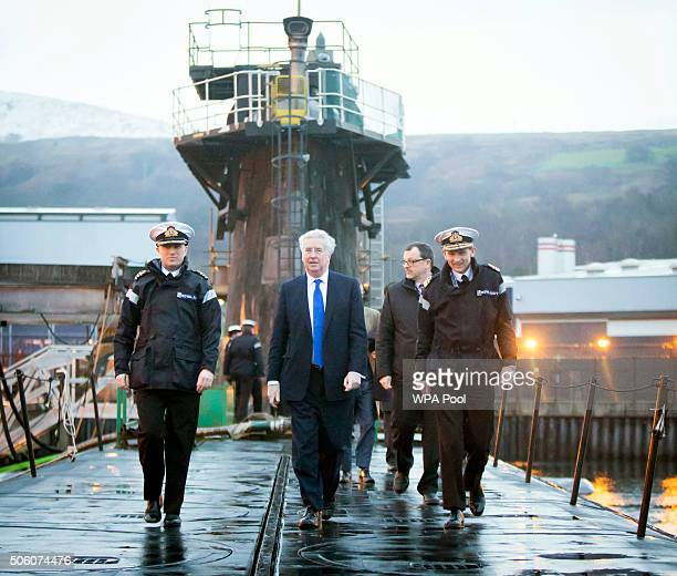 Defence Secretary Michael Fallon with Daniel Martyn Commanding Officer of HMS Vigilant and Rear Admiral of Submarines and Assistant Chief of Naval...