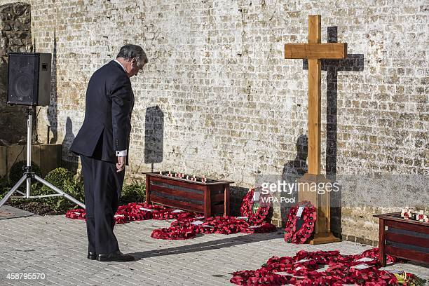 Defence secretary Michael Fallon lays a wreath during the Armistice day service at the Royal British Legion village which was attended by Defence...