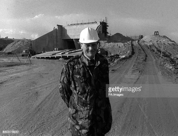 Defence Secretary Michael Heseltine MP wearing protective hat and combat jacket outside a quick reaction alert silo during a tour of the construction...