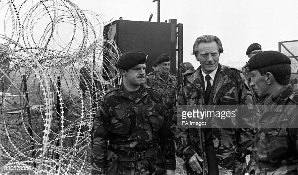 Defence Secretary Michael Heseltine with troops at RAF Molesworth Cambs after 100 anticruise missile protestors were evicted from the base in a joint...