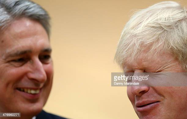 Defence secretary Philip Hammond and Mayor of London Boris Johnson joke to each other at the lunch of the new international sporting event for...