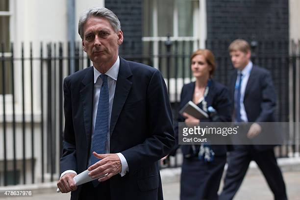Defence Secretary Philip Hammond leaves Downing Street after attending an emergency security meeting following the deadly attacks on tourists in...