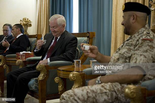 US Defence Secretary Robert Gates drinks Arabic coffee as he speaks with Emirati Deputy Chief of Staff Major General Ali alKaabi upon the former's...