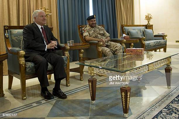 US Defence Secretary Robert Gates meets with Emirati Deputy Chief of Staff Major General Ali alKaabi upon his arrival at AlDhafra Air Base in Abu...
