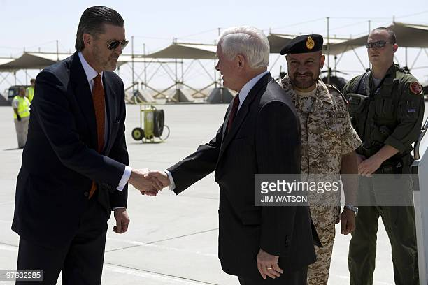 US Defence Secretary Robert Gates shakes hands with US Ambassador to the UAE Richard Olson after being greeted by Emirati Deputy Chief of Staff Major...