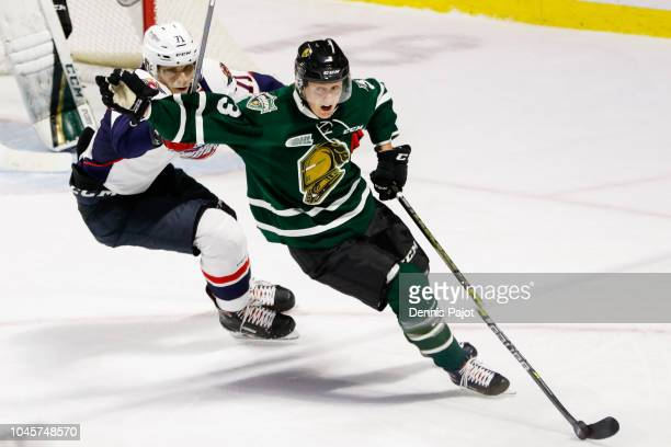 Defenceman Adam Boqvist of the London Knights moves the puck against defenceman Lev Starikov of the Windsor Spitfires on October 4 2018 at the WFCU...
