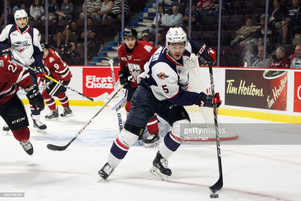 Defenceman Austin McEneny #5 of the Windsor Spitfires moves the puck against the Guelph Storm on September 24, 2017 at the WFCU Centre in Windsor, Ontario, Canada.