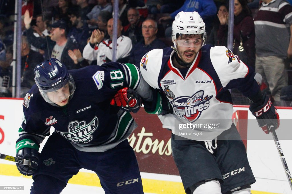 Defenceman Austin McEneny #5 of the Windsor Spitfires skates against forward Sami Moilanen #18 of the Seattle Thunderbirds on May 21, 2017 during Game 3 of the Mastercard Memorial Cup at the WFCU Centre in Windsor, Ontario, Canada.