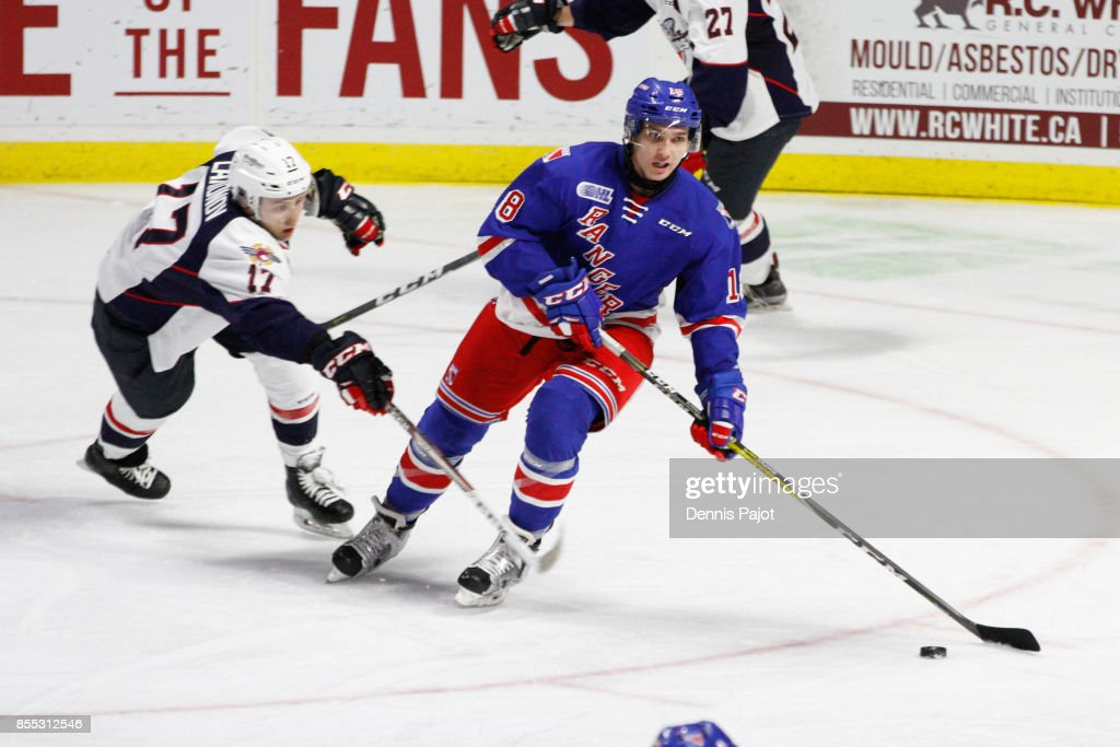 Defenceman Doug Blaisdell #18 of the Kitchener Rangers moves the puck against forward Igor Larionov #17 of the Windsor Spitfires on September 28, 2017 at the WFCU Centre in Windsor, Ontario, Canada.